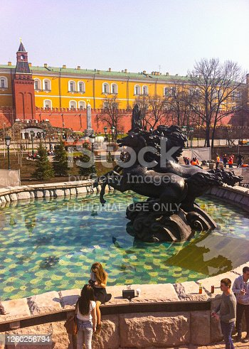istock Tourists having a break on a fountain close to Kremlin and Moscow Red Square 1260256794