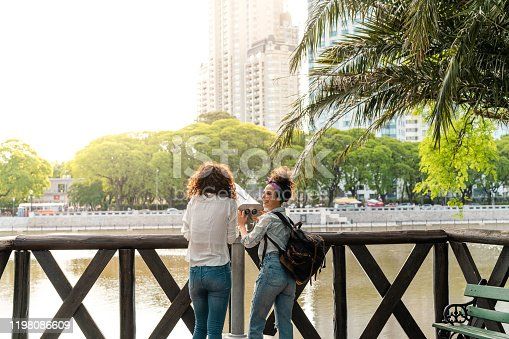 Two female best friends are laughing and having fun exploring the city of Buenos Aires.