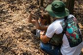 istock Tourists hide into war tunnels in Cu Chi, Vietnam 1281967703