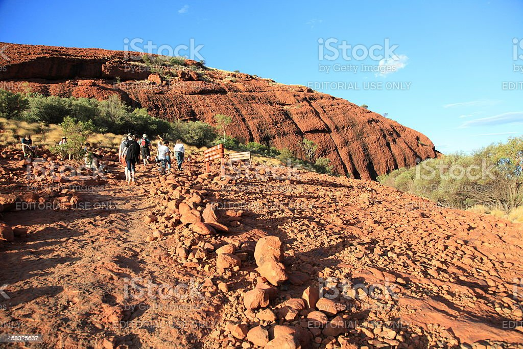 Tourists Hiking In the Olgas stock photo