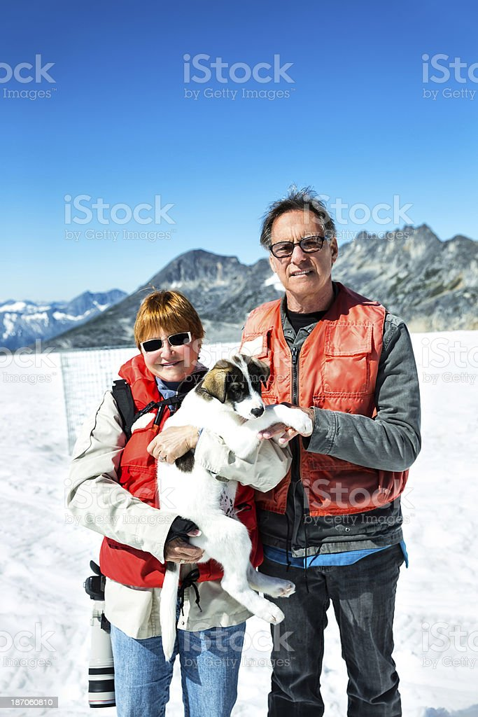 Tourists holding a sled dog in Skagway, Alaska royalty-free stock photo