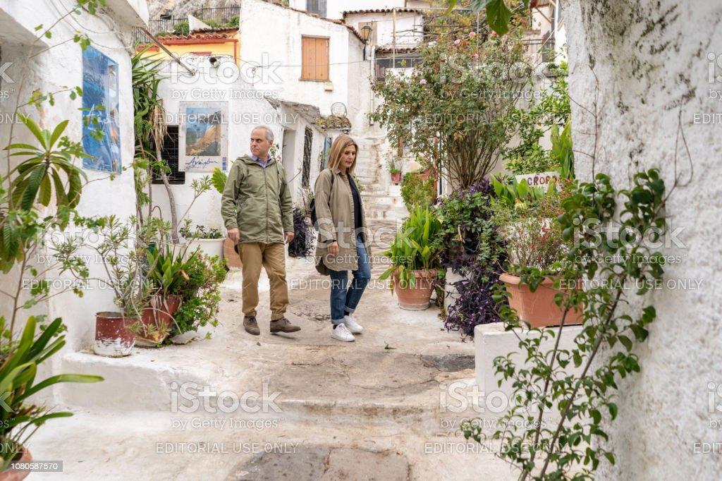 Tourists in Anafiotika in Athens, Greece stock photo