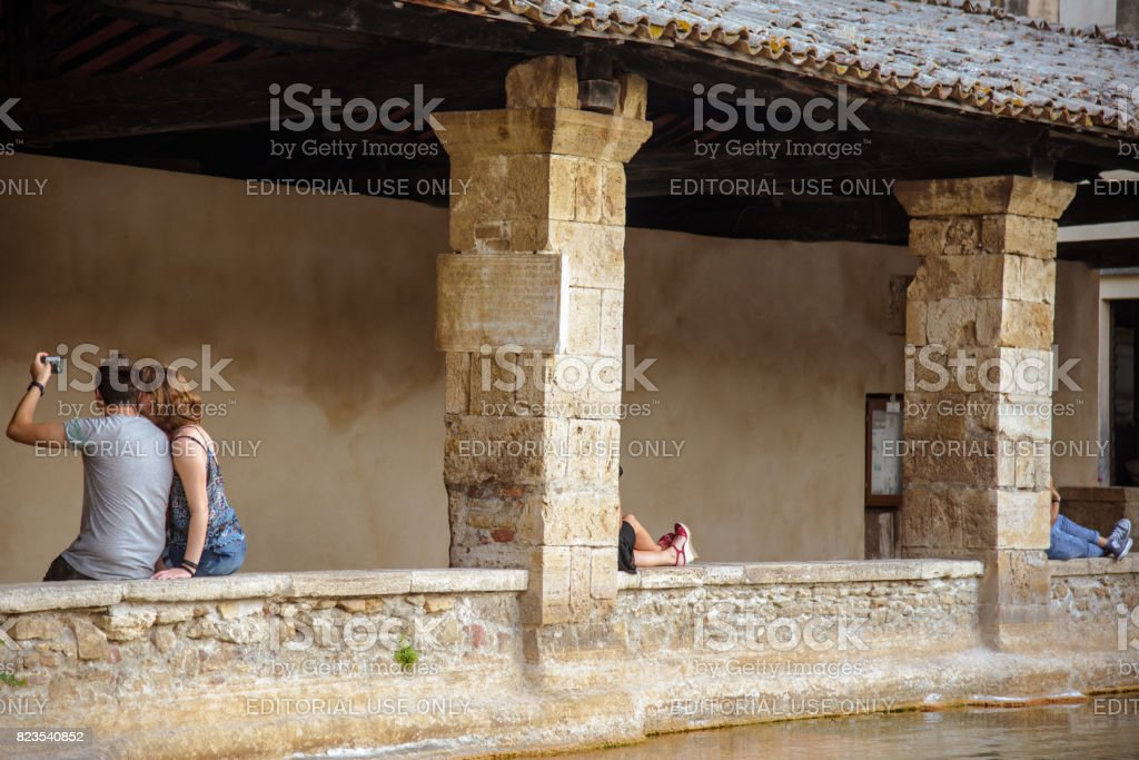 Tourists in Bagno Vignoni, Tuscany. stock photo