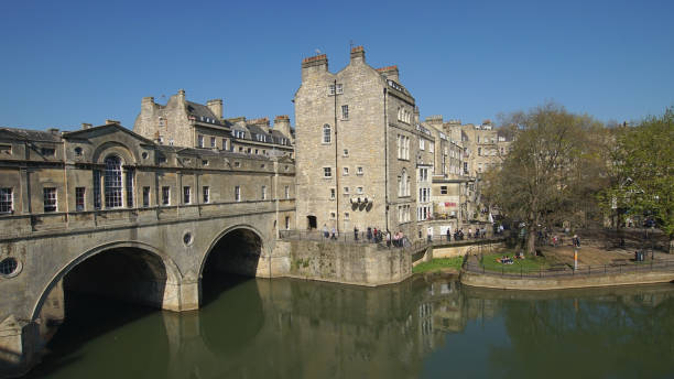 tourists in bath city in England many tourists are enjoying nice weather in summer at the ancient landmark bridge n bath city in England avon colorado stock pictures, royalty-free photos & images