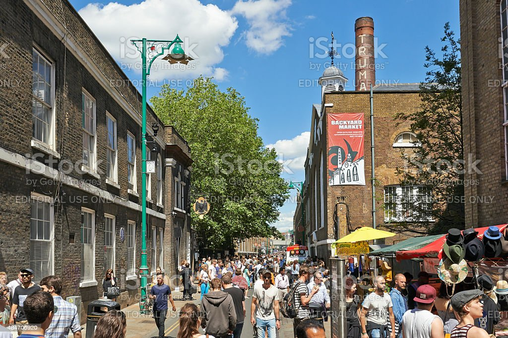Tourists in Brick Lane on a busy sunny Sunday stock photo