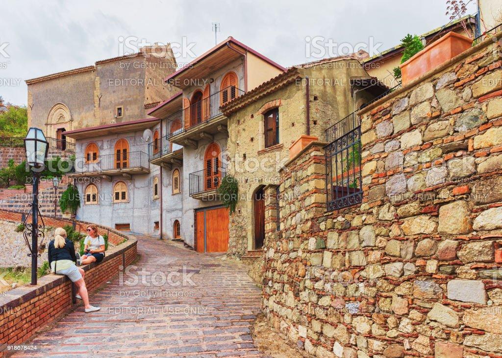 Tourists in cozy street of Savoca village stock photo