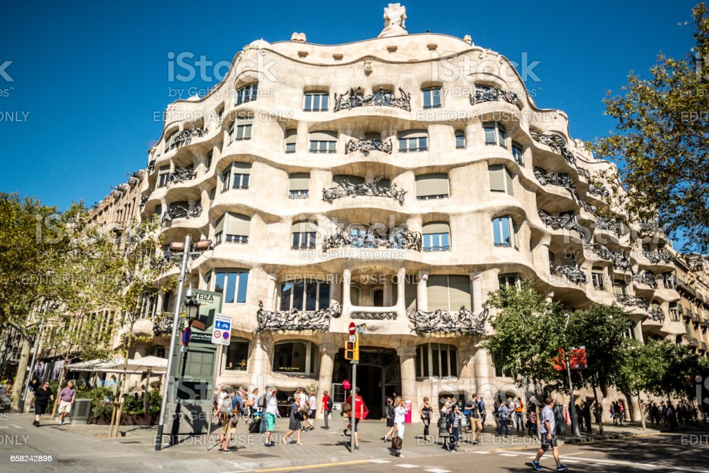 Tourists in front of famous Casa Mila, Barcelona, Spain stock photo