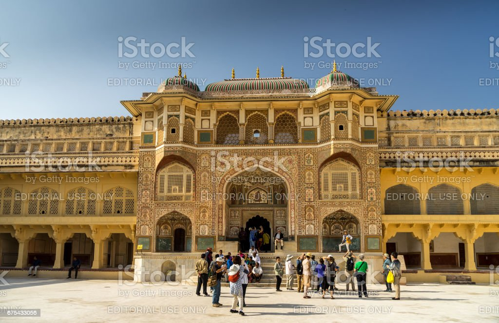 Amber, India - March 3, 2017. Tourists in front of Ganesh Pol at Amber Palace royalty-free stock photo