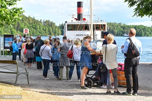 Stockholm, SWEDEN - 25 July, 2017 : Tourists waiting for the boat ride in front of the Drottningholm Palace.