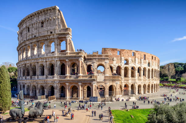 tourists in front of The Roman Colosseum, Rome, Italy march 9, 2017 - Rome, Italy: tourists in front of The Roman Colosseum, Rome, Italy coliseum rome stock pictures, royalty-free photos & images
