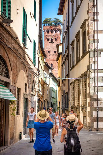 istock tourists in front of Torre Guinigi in Lucca, Italy 1261813261