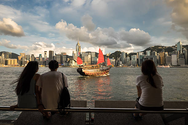 Tourists in Hong Kong watching over Victoria Harbour stock photo