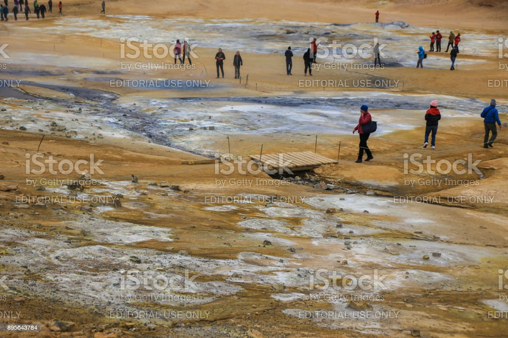 Tourists in Hverir Geothermal Area, Iceland stock photo