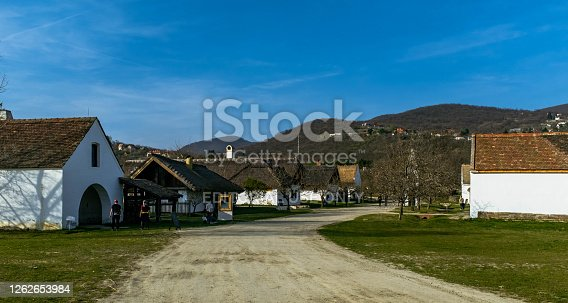 Szentendre, Hungary - March 30, 2019: Tourists exploring exposition of traditional Hungarian houses in Szentendre Skanzen Village Museum.