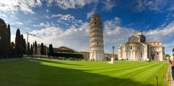 PISA - OCTOBER 10, 2016: Tourists in Square of Miracles. Pisa attracts 3 million people annually PISA - OCTOBER 10, 2016: Tourists in Square of Miracles. Pisa attracts 3 million people annually. annually stock pictures, royalty-free photos & images