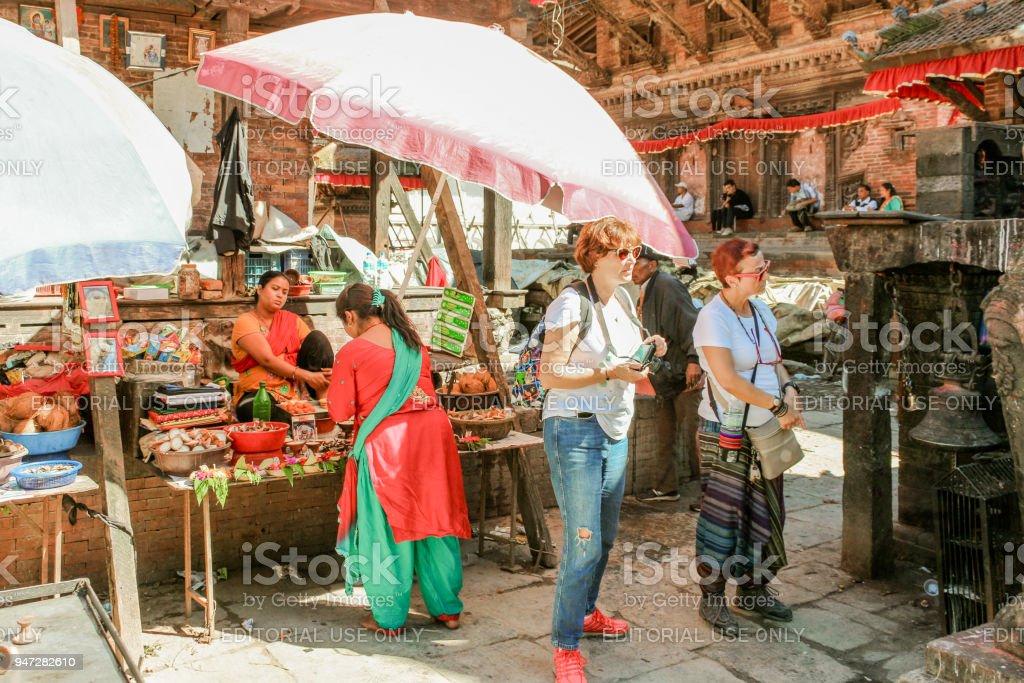 Tourists in street bazaar in Bhaktapur Durbar Square, Basantapur, Kathmandu, Nepal stock photo