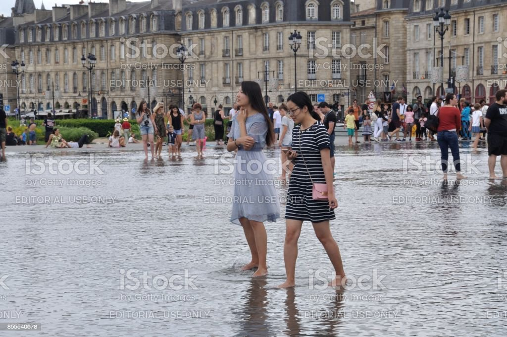 Tourists in the city center of Bordeaux on water mirror stock photo
