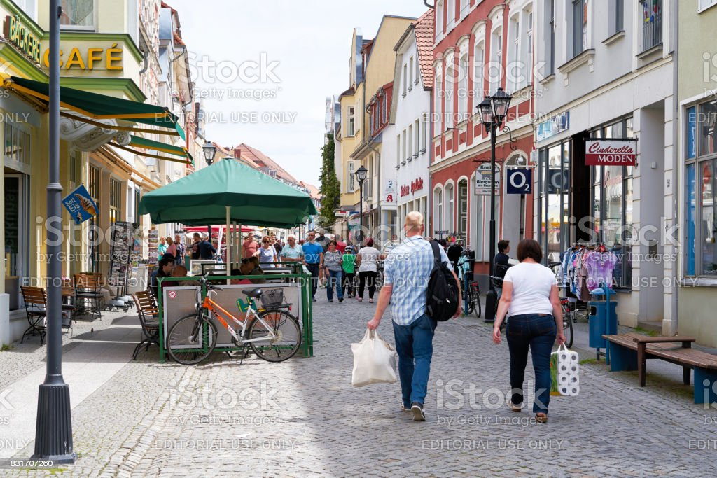 Tourists in the old town of Waren stock photo