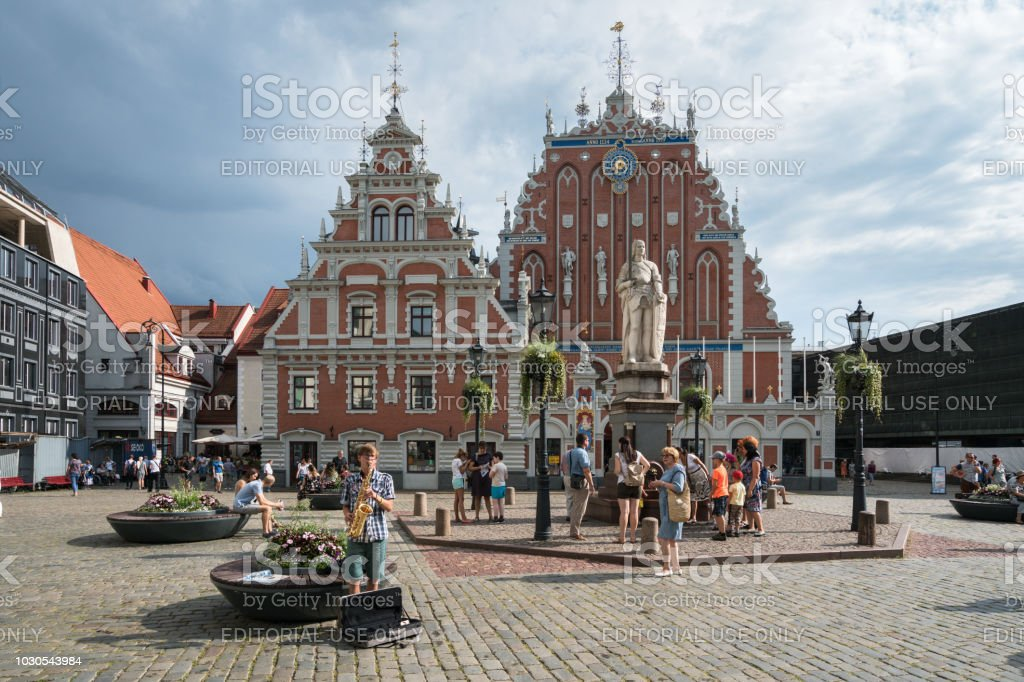 Tourists in the Old Town Square, next to statue of Roland and Blackheads house stock photo
