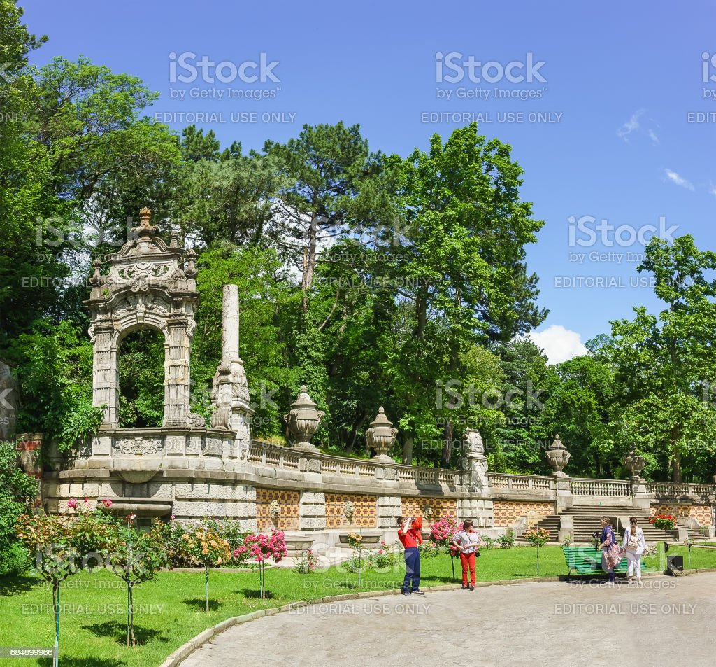 YALTA, CRIMEA, RUSSIA - JUNE 07.2016: Tourists in the Park of Massandra Palace of Emperor Alexander III . stock photo