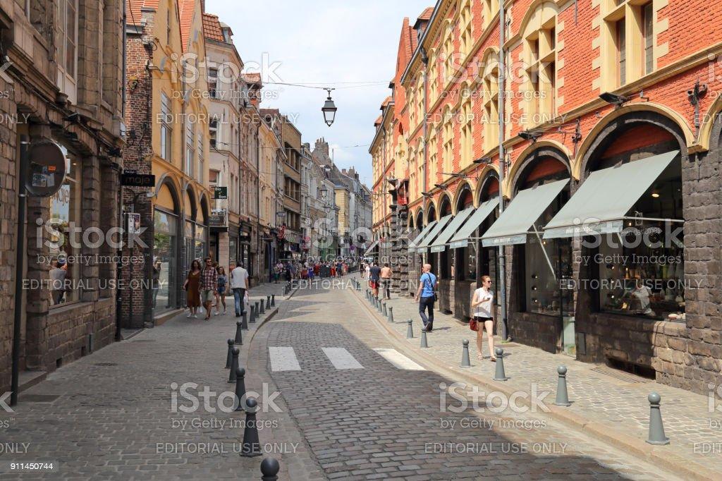 Tourists in the Rue de la Monnaie in Lille, France stock photo