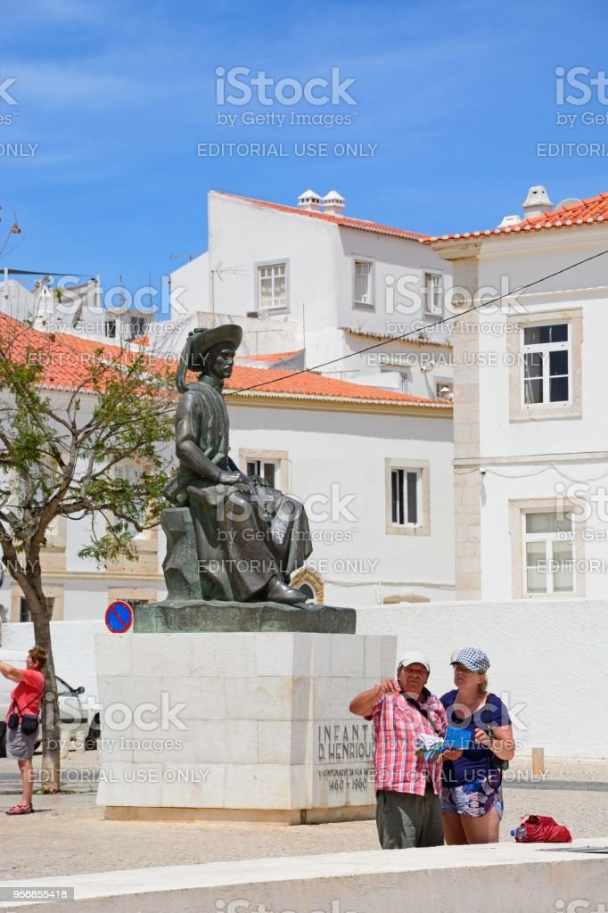 Tourists in the town square, Lagos, Portugal. stock photo