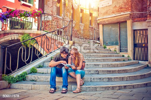 Young couple reading a guide book in Venice, Italy
