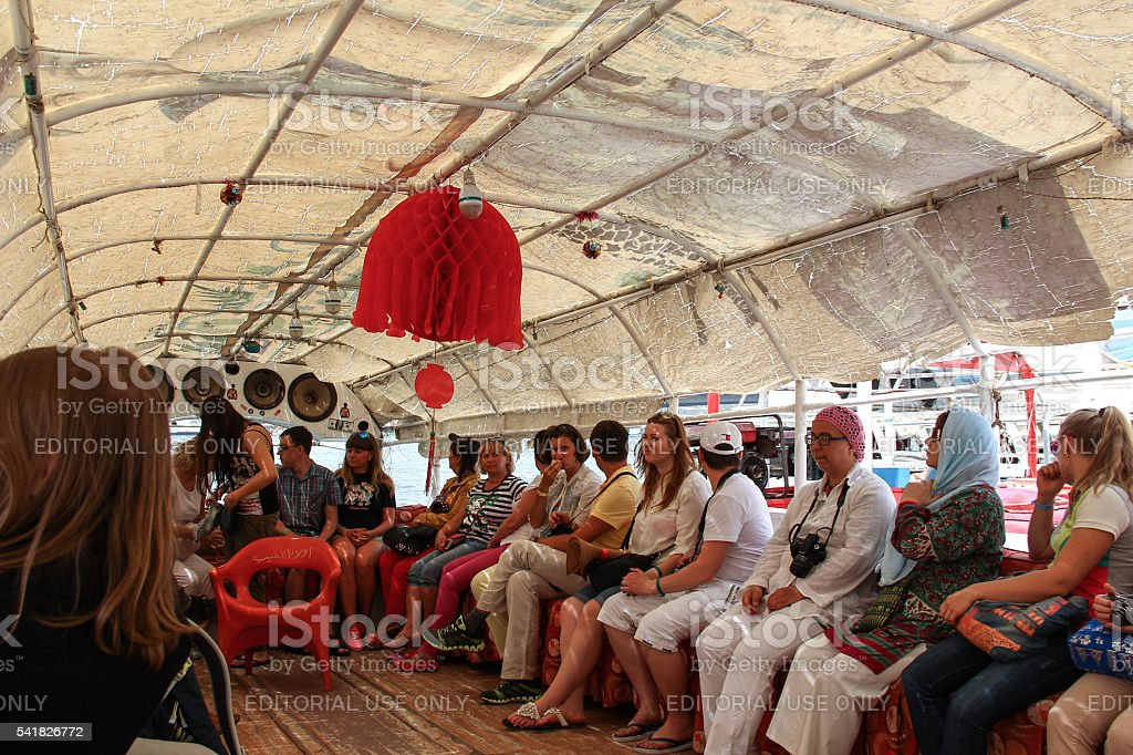 Tourists inside a roofed pleasure boat on the Nile stock photo