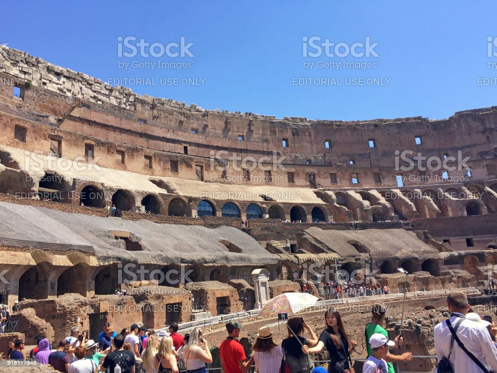 Tourists inside Colosseum (Coliseum) in Rome, Italy. stock photo