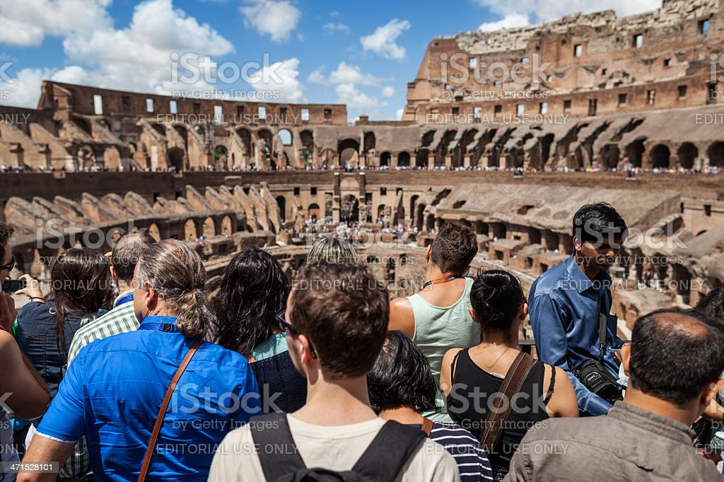 Tourists inside the Coliseum of Rome royalty-free stock photo