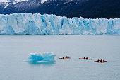El Calafate, Argentina - Sep 29, 2018: Tourists kayaking near the Perito Moreno Glacier in the Los Glaciares National Park in Argentina