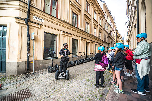 tourists listening instructiions how to use segway, stockholm - stockholm guide stock-fotos und bilder