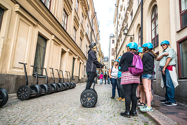 tourists listening instructions how to use segway, stockholm - stockholm guide stock-fotos und bilder