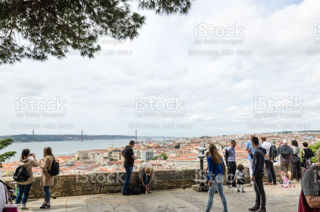 Tourists looking at a scenic view in Lisbon stock photo