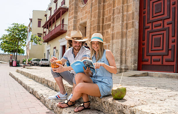 Tourists looking at a travel guide stock photo