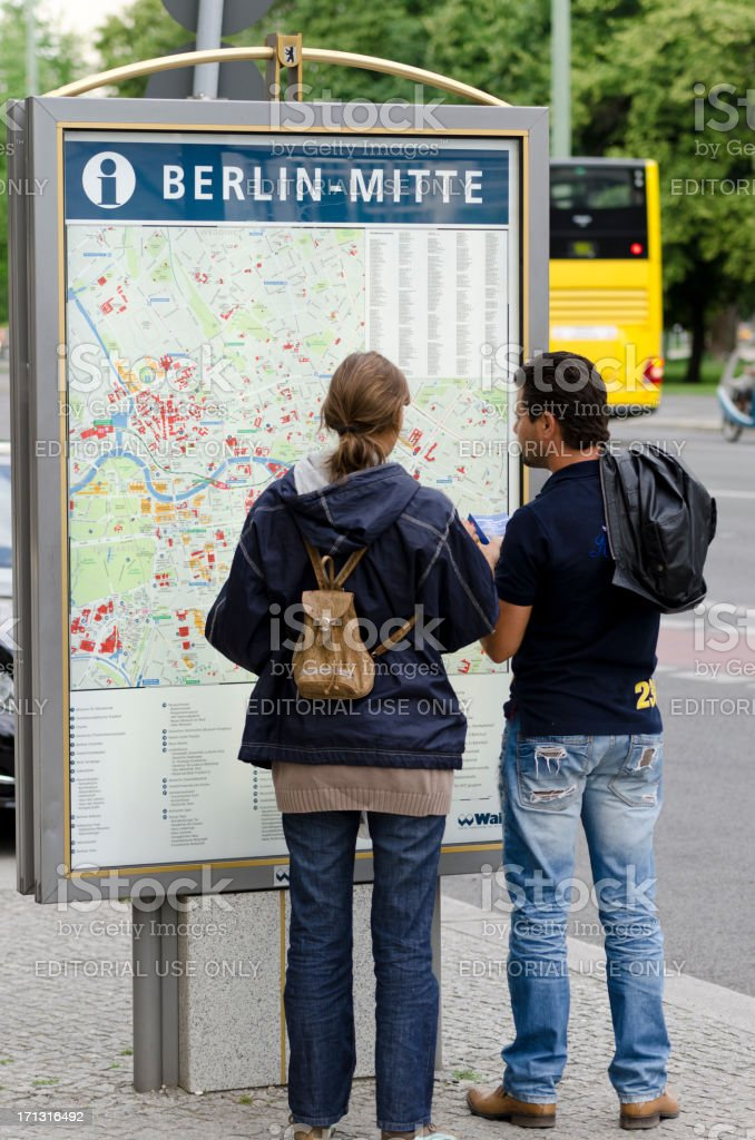 Tourists looking at Berlin map royalty-free stock photo