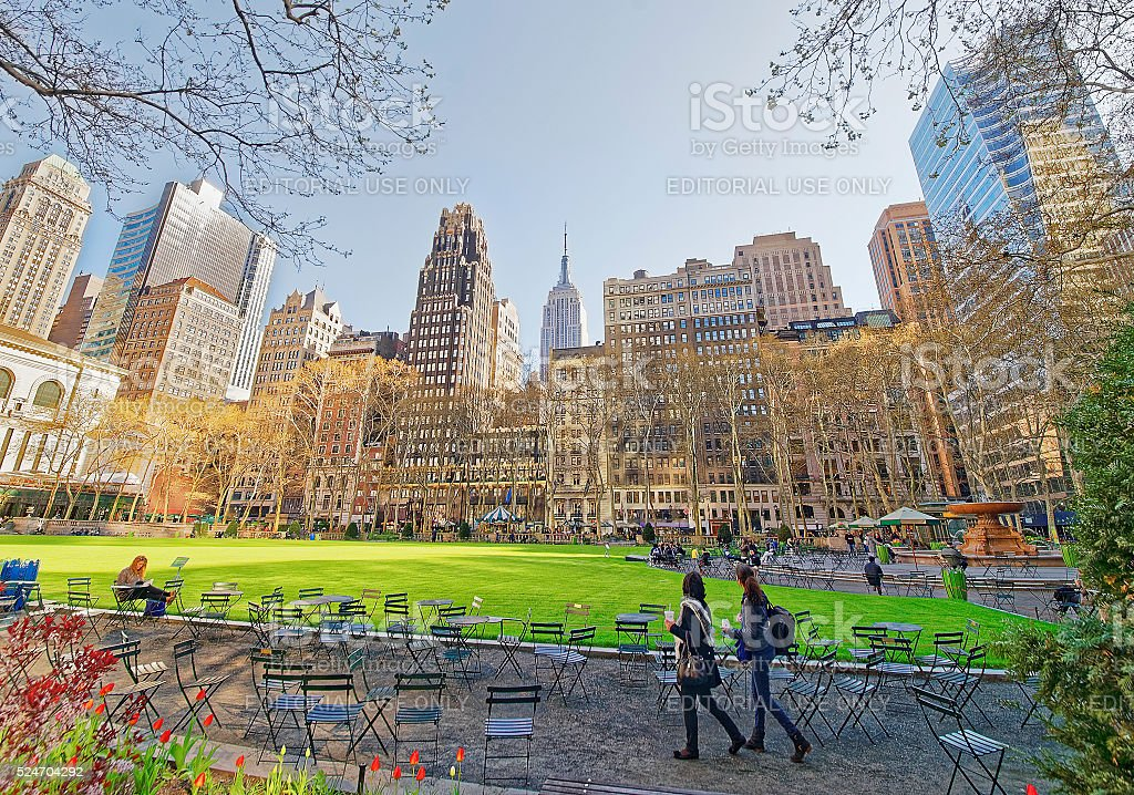 Tourists looking at Green Lawn and Skyscrapers in Bryant Park stock photo