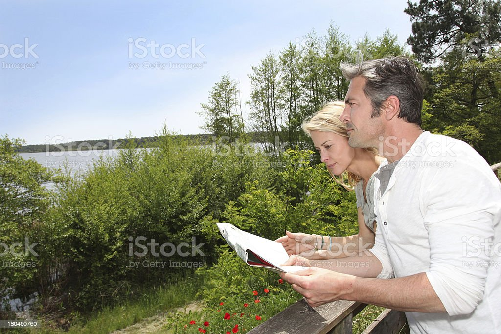 Tourists looking at map before visiting royalty-free stock photo
