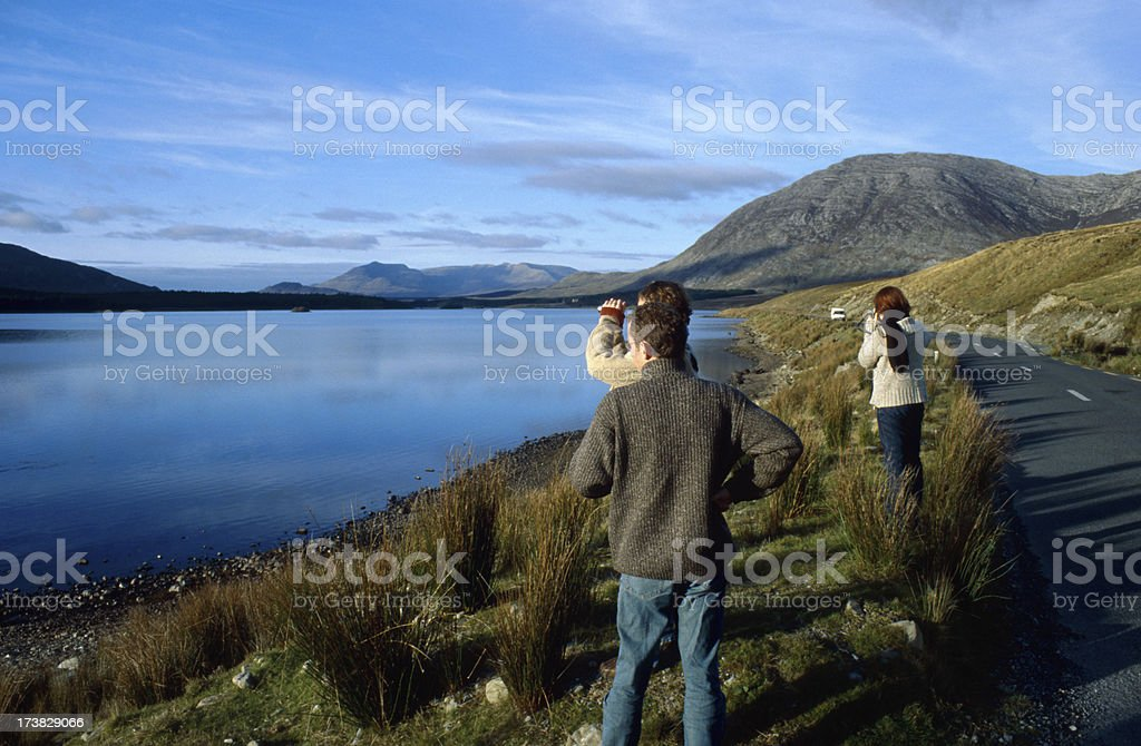 tourists looking at panoramic view stock photo