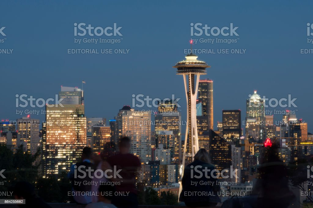 Tourists looking at Seattle Skyline at night from Kerry Park royalty-free stock photo