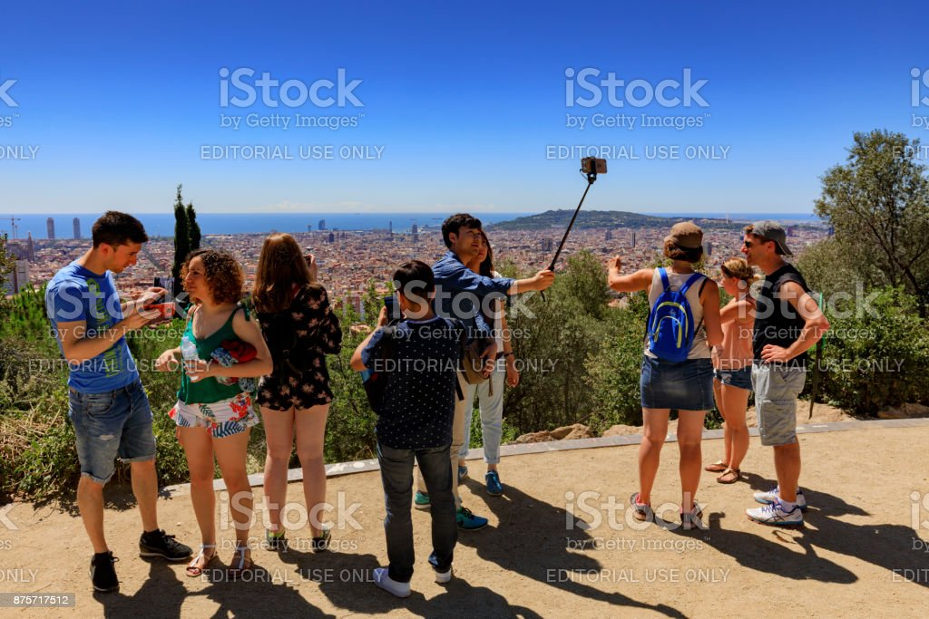 tourists looking at the city from Park Guell in Barcelona stock photo