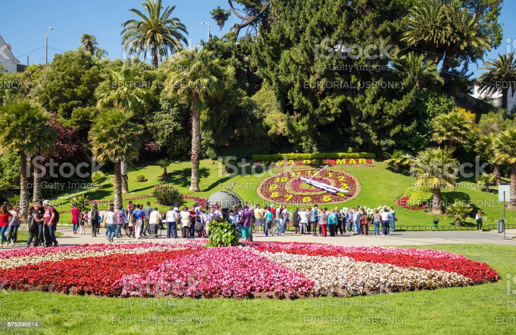 Tourists looking at the flower clock (Reloj de Flores) in Vina del Mar, Chile stock photo