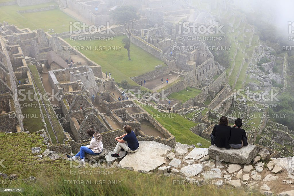Tourists looking over Machu Picchu royalty-free stock photo