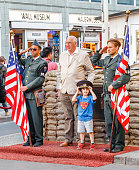 Tourists making photographs with the military people at the checkpoint Charlie