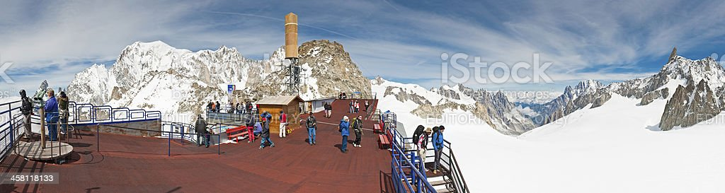 Tourists mountain cable car station Mont Blanc Italy panorama stock photo