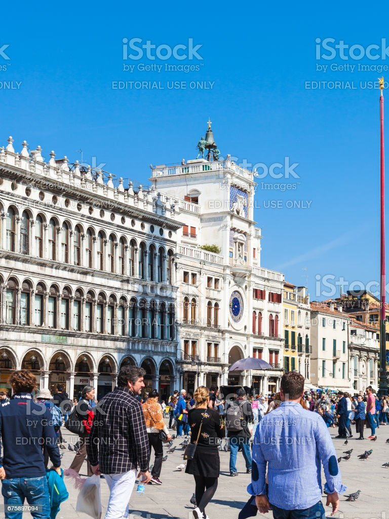 tourists near Clock Tower on St Mark's Square stock photo