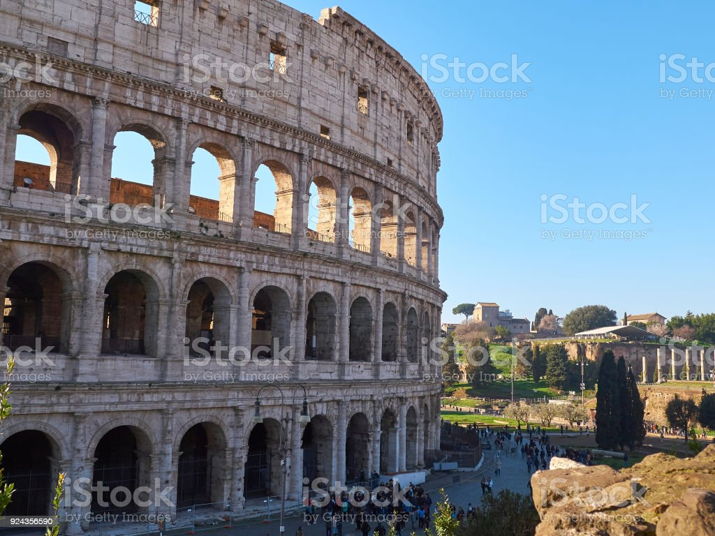 Tourists near Colosseum, also known as the Flavian Amphitheatre. Rome, Italy stock photo
