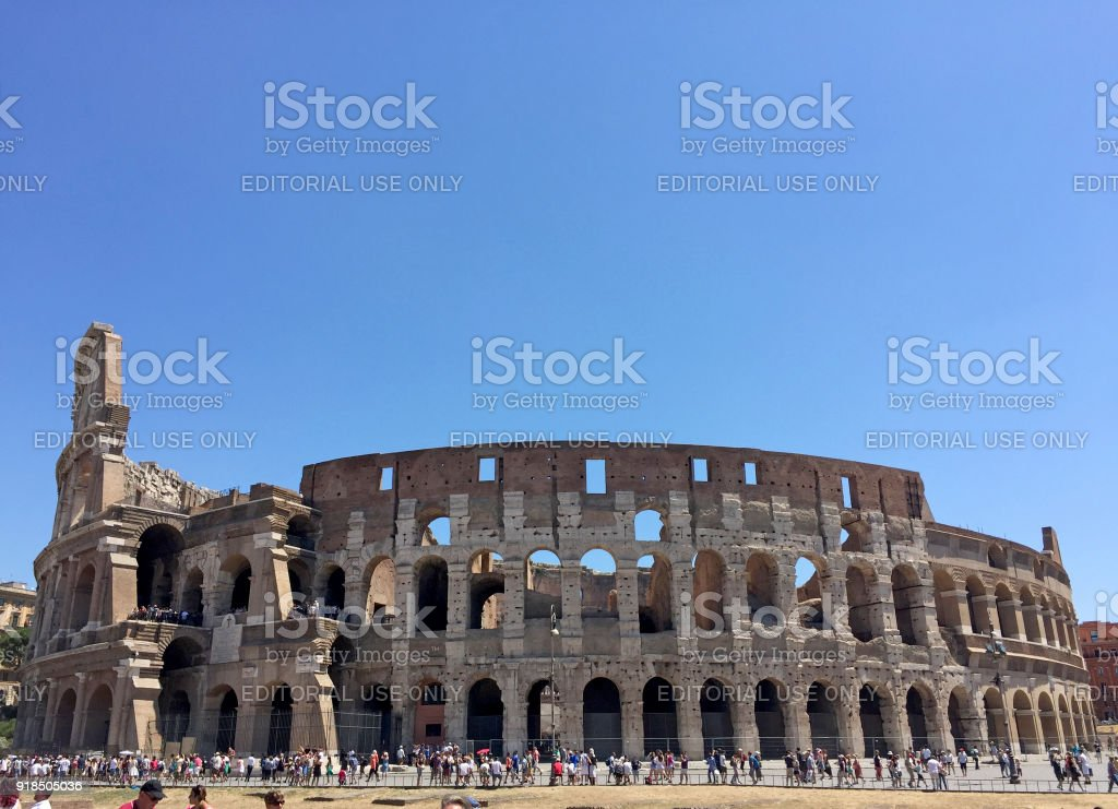 Tourists near Colosseum in Rome, Italy. stock photo