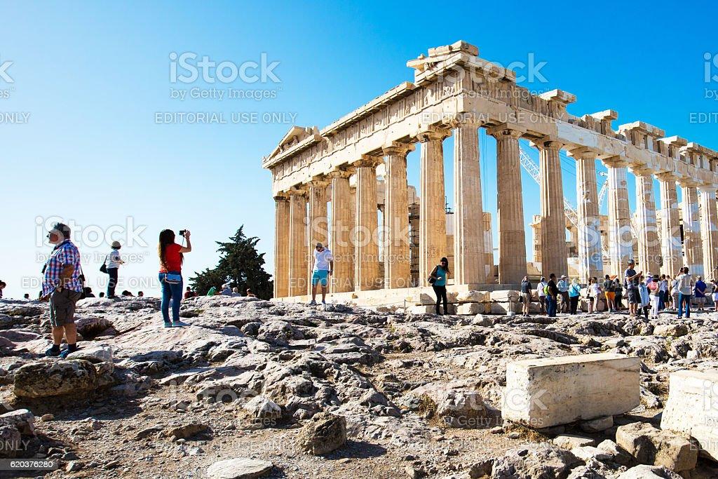 Tourists near Parthenon temple in Acropolis in Athens, Greece stock photo