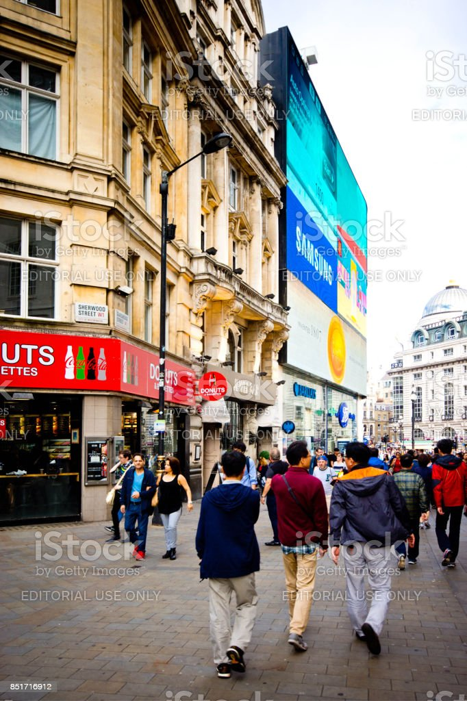 Tourists near Piccadilly Circus stock photo
